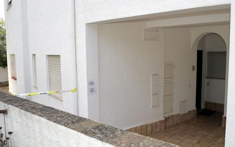 The entrance to the resort apartment at the Ocean Club where Madeleine and her family were staying when she disappeared. - Credit: AP Photo/Carlos Cesar