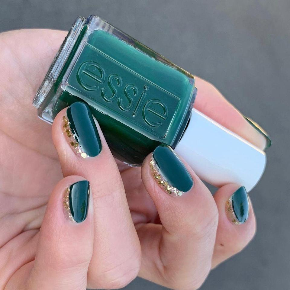 """A hint of sparkle along the side is both interesting and easy. Get the look with Essie in <a href=""""https://shop-links.co/1724784916516686632"""" rel=""""nofollow noopener"""" target=""""_blank"""" data-ylk=""""slk:Off Tropic"""" class=""""link rapid-noclick-resp"""">Off Tropic</a> and <a href=""""https://www.target.com/p/essie-luxeffects-top-coat/-/A-16194902"""" rel=""""nofollow noopener"""" target=""""_blank"""" data-ylk=""""slk:gold Luxeffects Top Coat."""" class=""""link rapid-noclick-resp"""">gold Luxeffects Top Coat.</a>"""