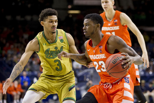Syracuse's Frank Howard (23) drives by Notre Dame's Prentiss Hubb (3) during the first half of an NCAA college basketball game Saturday, Jan. 5, 2019, in South Bend, Ind. (AP Photo/Robert Franklin)