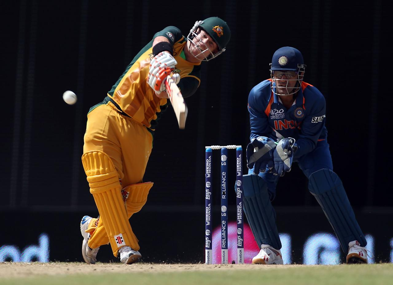 BRIDGETOWN, BARBADOS - MAY 07:  David Warner of Australia hits a six during the ICC World Twenty20 Super Eight match between Australia and India at the Kensington Oval on May 7, 2010 in Bridgetown, Barbados.  (Photo by Clive Rose/Getty Images)