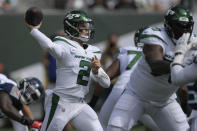 New York Jets quarterback Zach Wilson passes during the first half of an NFL football game against the Tennessee Titans, Sunday, Oct. 3, 2021, in East Rutherford. (AP Photo/Bill Kostroun)