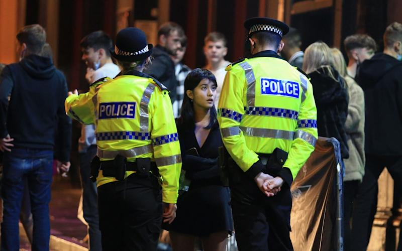Liverpool police and revellers - LINDSEY PARNABY/AFP via Getty Images
