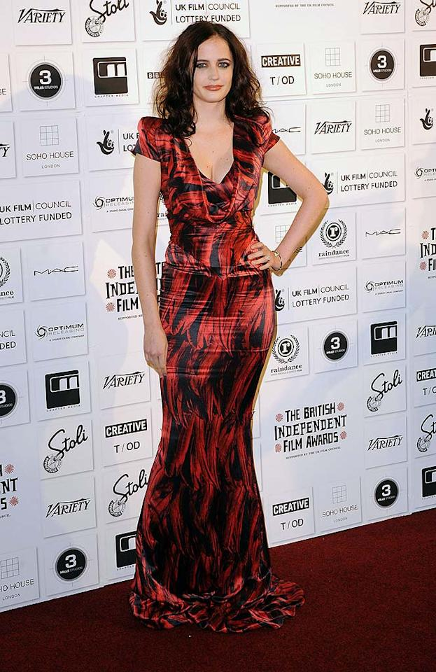 "Though she stumbled a few times on the long train of her flowing Alexander McQueen gown, Bond Girl Eva Green looked ravishing in her red and black feather print number at the British Independent Film Awards in London. Eamonn McCormack//<a href=""http://www.wireimage.com"" target=""new"">WireImage.com</a> - December 6, 2009"