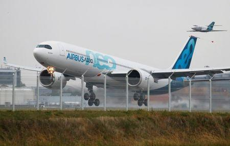 An Airbus A330neo aircraft lands during its maiden flight event in Colomiers near Toulouse, France, October 19, 2017.   REUTERS/Regis Duvignau