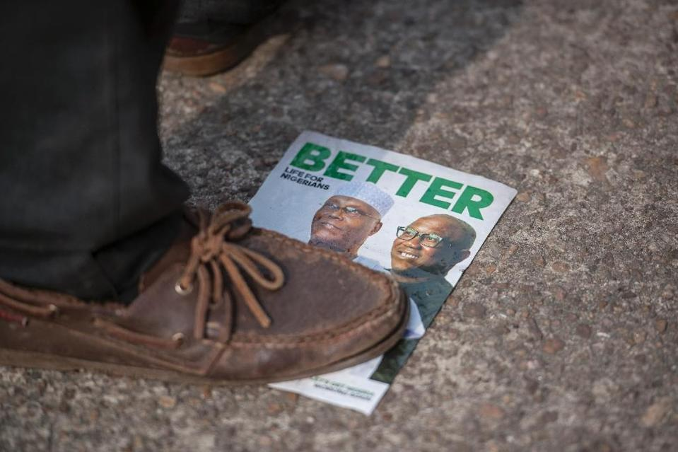 Tensions have risen between All Progressives Congress of President Mohammadu Buhari and the People's Democratic Party ahead of Nigeria's election on Saturday (AFP Photo/CRISTINA ALDEHUELA)