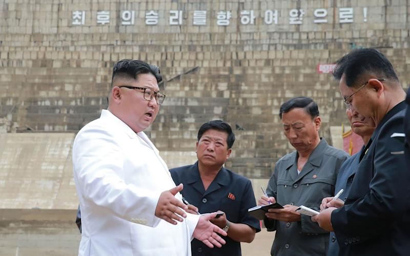 Kim had harsh words for workers ata delayed electrical power plant at Orang river in North Hamgyong Province - AFP