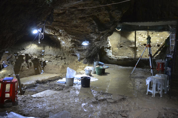 This image provided by Tsenka Tsanova in May 2020 shows excavation work at the Bacho Kiro Cave in Bulgaria. Two new studies Monday show that Homo sapiens bones found in the Bulgarian cave date back to as far as 46,000 years ago, which is thousands of years earlier than previous human fossils in Europe.(Tsenka Tsanova/MPI-EVA Leipzig via AP)