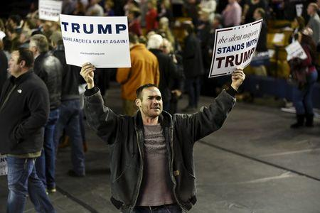 A supporter of U.S. Republican presidential candidate Donald Trump tries to get the crowd fired up at a campaign rally at Oral Roberts University in Tulsa, Oklahoma January 20, 2016.    REUTERS/Nick Oxford