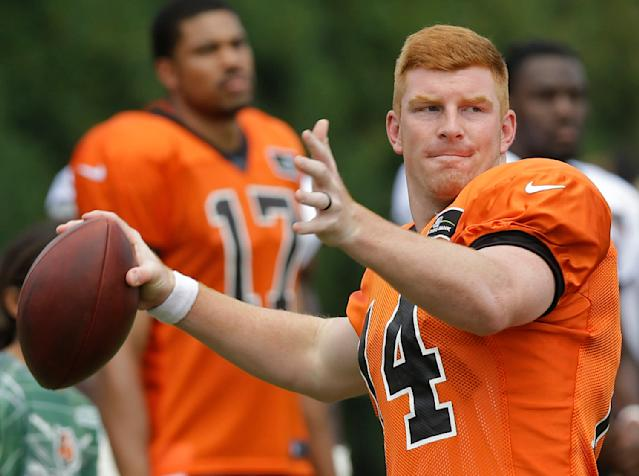 Cincinnati Bengals quarterback Andy Dalton passes the ball during practice at the NFL football team's training camp on Saturday, July 26, 2014, in Cincinnati. (AP Photo/Al Behrman)