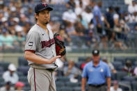 Minnesota Twins pitcher Kenta Maeda gestures to Rougned Odor after hitting him with a pitch in the second inning of a baseball game, Saturday, Aug. 21, 2021, in New York. (AP Photo/Mary Altaffer)