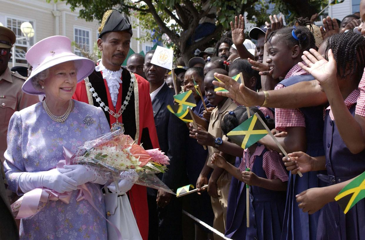 Queen Elizabeth II, accompanied by the Mayor of Montego Bay, Hugh Solomon, meets locals at Sam Sharpe Square, Montego Bay Jamaica, during her Jubilee overseas tour.   (Photo by Fiona Hanson - PA Images/PA Images via Getty Images)