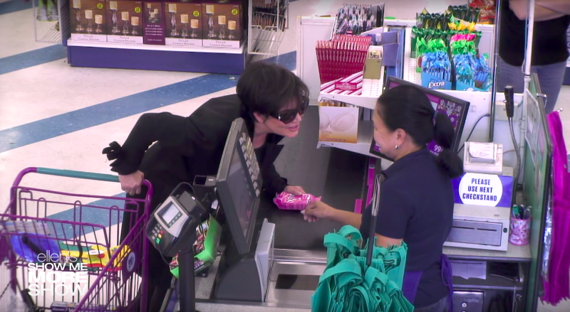 Kris Jenner leans in to whisper a secret to the cashier about a pack of razors. (The Ellen Show)