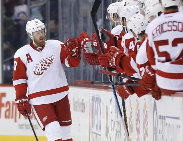 Detroit Red Wings' Johan Franzen (93) celebrates his goal against the Winnipeg Jets during the second period of an NHL hockey game, Thursday, Nov. 20, 2014 in Winnipeg, Manitoba. (AP Photo/Canadian Press, John Woods)