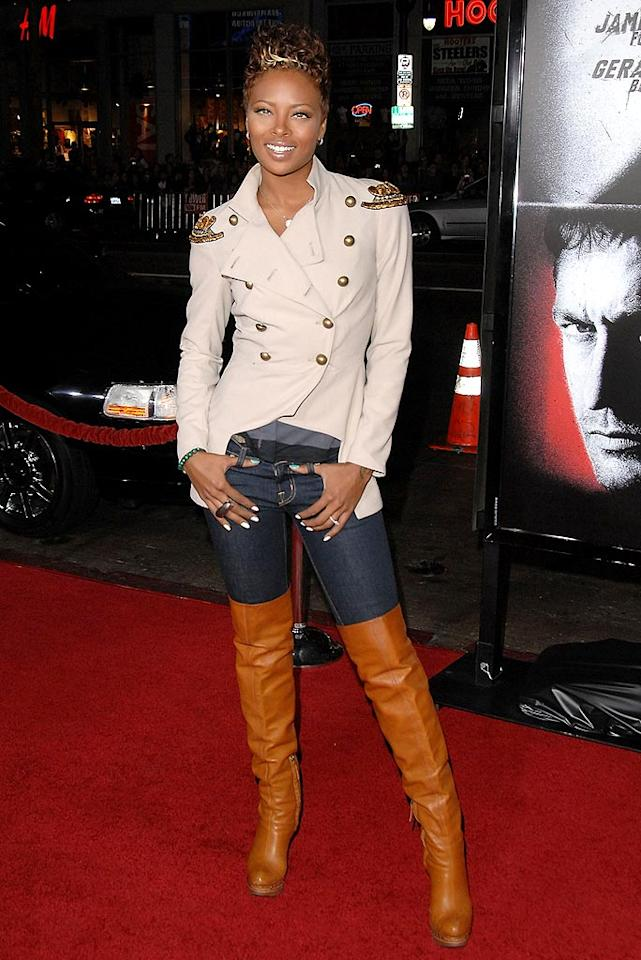 """Eva Marcille's hair is a hot mess, but we're secretly loving her military-inspired jacket and thigh-high leather boots. Discuss. Jon Kopaloff/<a href=""""http://www.filmmagic.com/"""" target=""""new"""">FilmMagic.com</a> - October 6, 2009"""