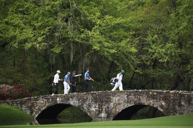 Sergio Garcia of Spain and his group of Bernd Wiesberger of Austria, Branden Grace of South Africa and Joaquin Niemann of Chile cross the Nelson Bridge over Rae's Creek to the 13th fairway during the final day of practice for the 2018 Masters golf tournament at Augusta National Golf Club in Augusta, Georgia, U.S. April 4, 2018. REUTERS/Mike Segar