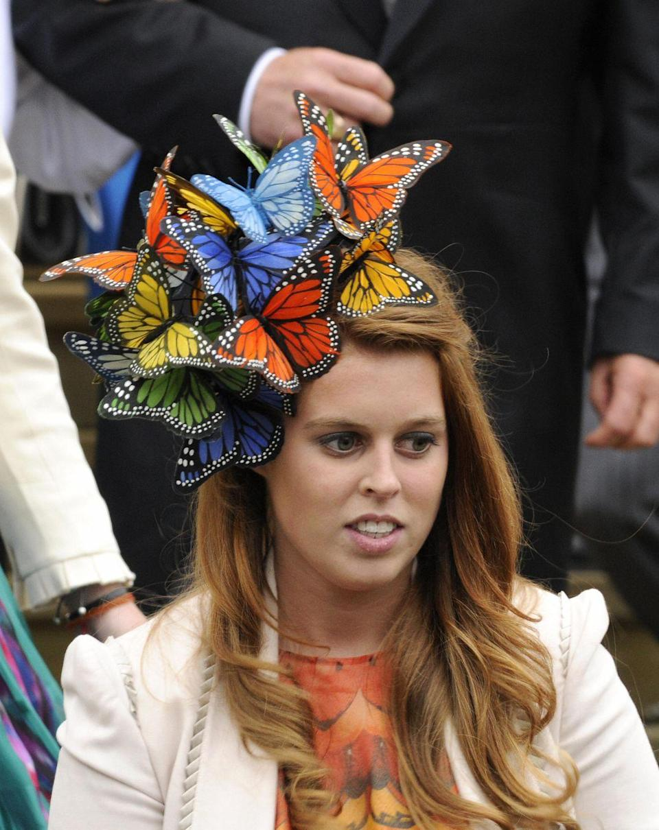 """<p>Princess Beatrice's bold fascinators, like this butterfly-themed one that she wore to the wedding of Peter Phillips to Autumn Kelly, are legendary.</p><p><strong><a href=""""https://www.townandcountrymag.com/style/fashion-trends/g15896831/princess-beatrice-best-hats/"""" rel=""""nofollow noopener"""" target=""""_blank"""" data-ylk=""""slk:See 13 of Her Most Memorable Hats Here."""" class=""""link rapid-noclick-resp"""">See 13 of Her Most Memorable Hats Here.</a></strong><br></p>"""