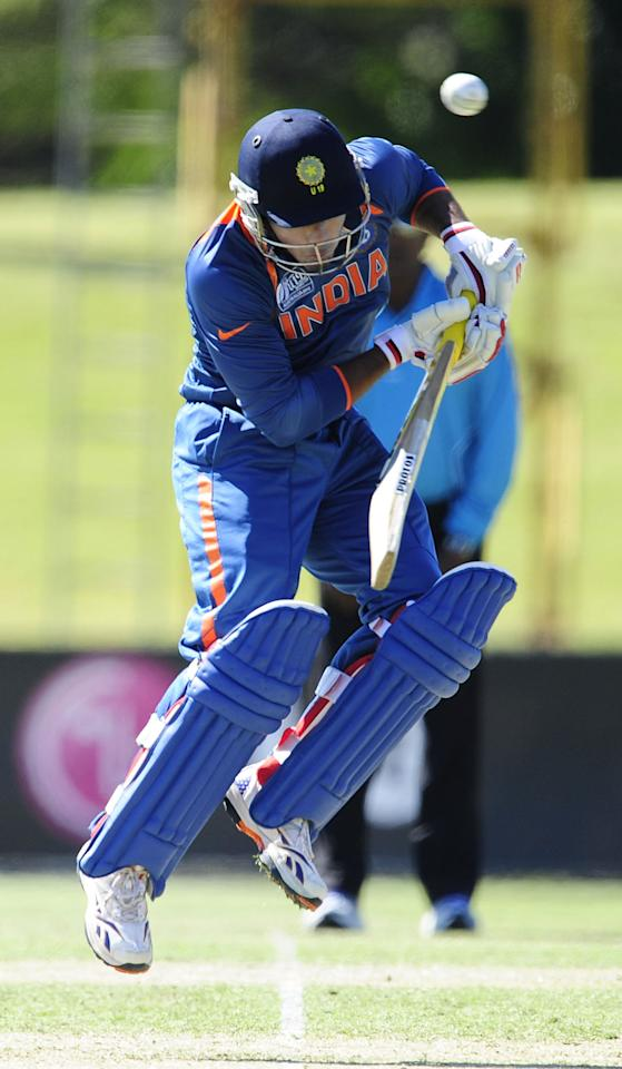 TOWNSVILLE, AUSTRALIA - AUGUST 14:  Unmukt Chand of India ducks under a bouncer during the ICC U19 Cricket World Cup 2012 match between India and Zimbabwe at Tony Ireland Stadium on August 14, 2012 in Townsville, Australia.  (Photo by Ian Hitchcock-ICC/Getty Images)