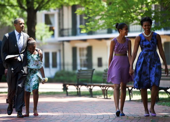 U.S. President Barack Obama (L) and first lady Michelle Obama (R) walk with their daughters Sasha (2L) and Malia (2R) through Lafayette Square from St. John's Protestant Episcopal Church to the White House July 17, 2011 in Washington, DC. The First Family attended Sunday services.(Photo by Brendan Smialowski-Pool/Getty Images)