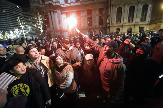<p>Philadelphia Eagles fans celebrate the team's victory in NFL Super Bowl 52 between the Philadelphia Eagles and the New England Patriots, Sunday Feb. 4, 2018, in downtown Philadelphia. (AP Photo/Matt Rourke) </p>