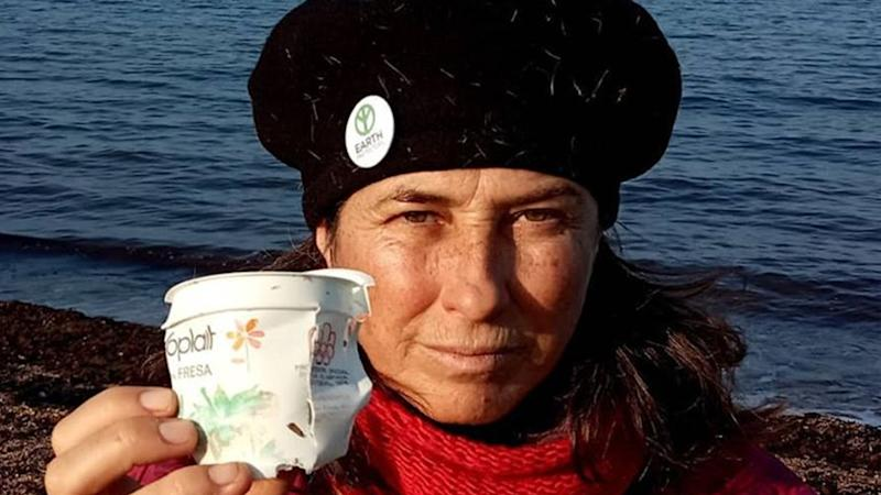 Maite Mompó is seen holding the yoghurt container at the beach in Denia. Source: Maite Mompó