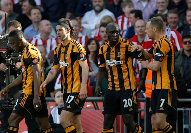 Hull City's Yannick Sagbo, second right, celebrates his goal against Sheffield United with teammates during their English FA Cup semifinal soccer match at Wembley Stadium in London, Sunday, April 13, 2014. (AP Photo/Sang Tan)