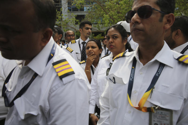 Employees of Jet Airways gather to demand clarification on unpaid salaries at Jet Airways headquarters in Mumbai, India, Monday, April 15, 2019. India's ailing Jet Airways has drastically reduced operations amid talks with investors to purchase a controlling stake in the airline and help it reduce its mounting debt. (AP Photo/Rafiq Maqbool)