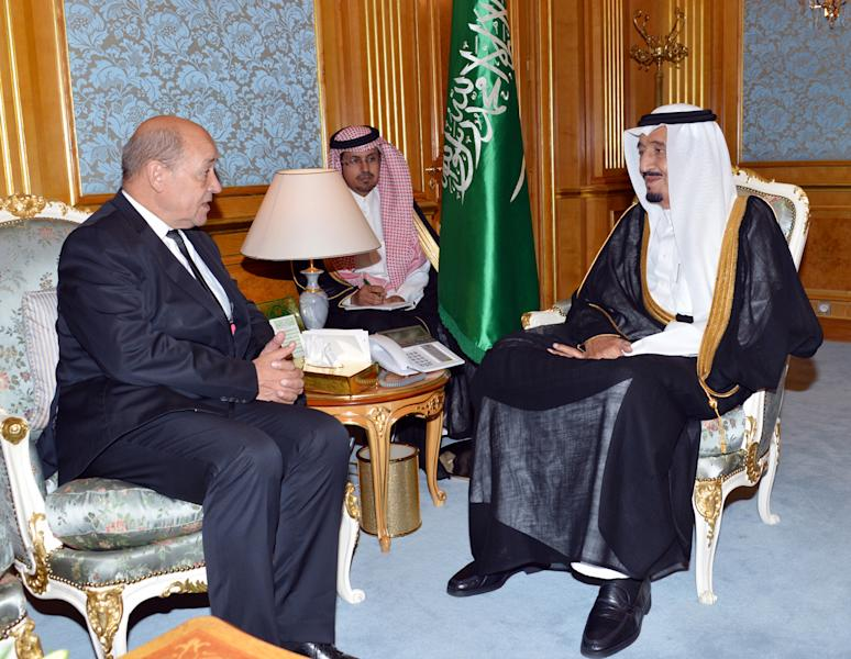 In this photo released by the Saudi Press Agency, Saudi Crown Prince Salman bin Abdul-Aziz, right, meets with French Defense Minister Jean-Yves Le Drian in Jiddah, Saudi Arabia, Monday, Oct. 7, 2013. (AP Photo)