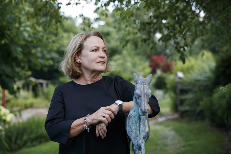 "FILE - In this July 12, 2019, file photo, former opera singer Patricia Wulf, poses for a portrait in her home in Virginia. Wulf and Angela Turner Wilson, who have accused Placido Domingo of sexual misconduct reacted angrily to his claims in recent interviews that he never behaved improperly and always acted gallantly and like a gentleman with women. They issued a statement Tuesday, Dec. 3, 2019, saying they found Domingo's comments and his ""continued failure to take responsibility for wrongdoing"" to be disappointing and deeply disturbing. (AP Photo/Jacquelyn Martin, File)"