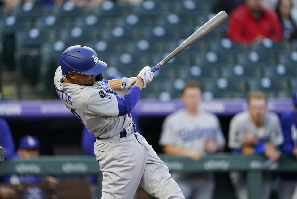 Los Angeles Dodgers' Mookie Betts connects for a double off Colorado Rockies starting pitcher Antonio Senzatela in the second inning of a baseball game Friday, April 2, 2021, in Denver. (AP Photo/David Zalubowski)