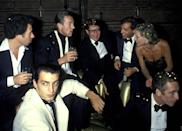 "<p>David Geffen, Halston, Yves Saint Laurent, Steve Rubell, Nan Kempner and Fernando Sanchez attend the ""Opium"" Perfume Launch After Party on September 20, 1978 at Studio 54 in New York City.</p>"
