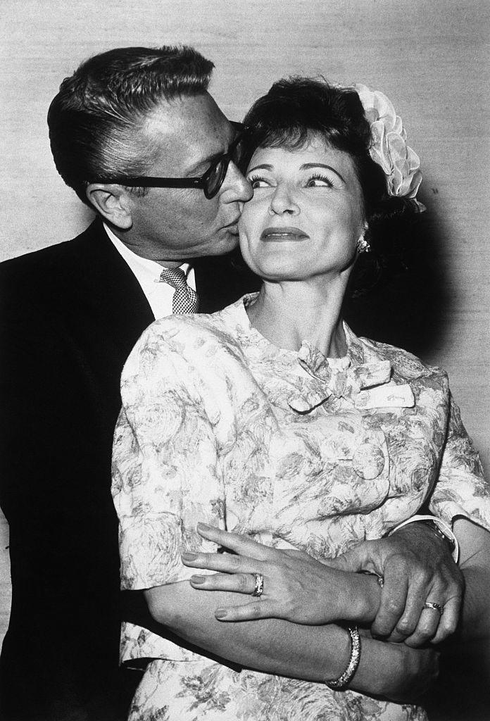 <p>The couple got married in a small ceremony at the Sands Hotel in Las Vegas on June 14, 1963. Betty wore a brocade scoop-neck suit and a white ruffled hatband. </p>