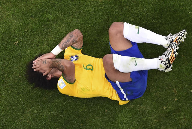 FILE - In this Tuesday, July 8, 2014 file photo, Brazil's Marcelo lies on the pitch during his team's 7-1 defeat in the World Cup semifinal soccer match against Germany at the Mineirao Stadium in Belo Horizontem Brazil. The 21st World Cup begins on Thursday, June 14, 2018, when host Russia takes on Saudi Arabia. (AP Photo/Francois Xavier Marit, Pool, File)