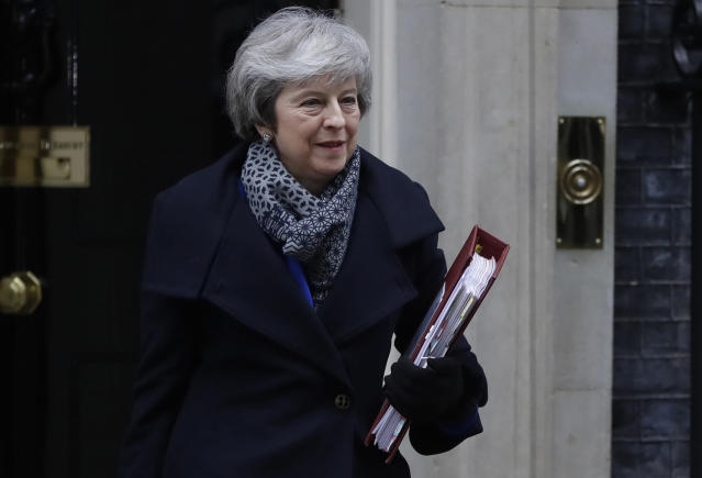 Prime Minister Theresa May leaves 10 Downing Street in London, Wednesday, Jan. 16, 2019. British lawmakers overwhelmingly rejected Prime Minister Theresa May's divorce deal with the European Union on Tuesday, plunging the Brexit process into chaos and triggering a no-confidence vote that could topple her government. (AP Photo/Kirsty Wigglesworth)