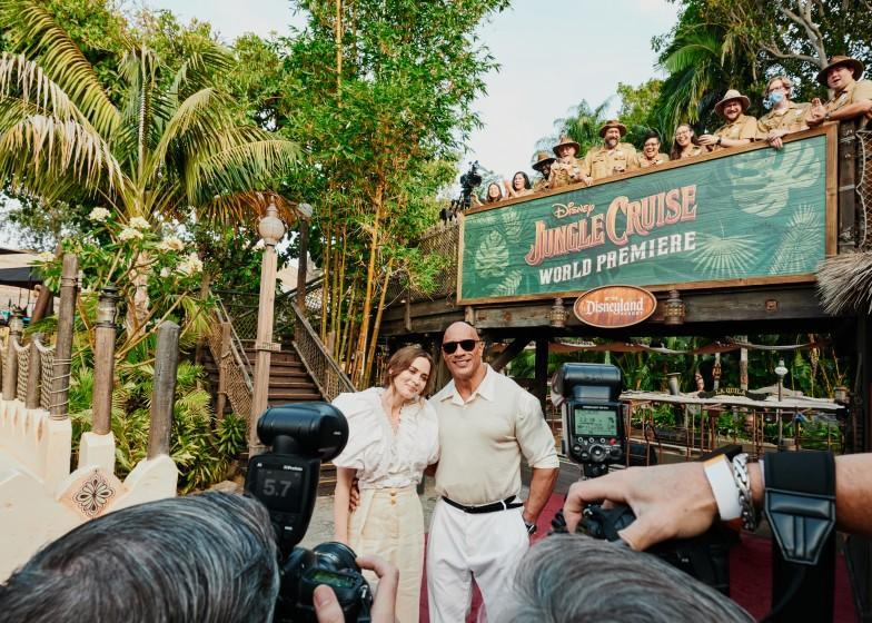 Anaheim, CA - 7/24/21: Emily Blunt and Dwayne Johnson exit the Jungle Cruise ride and pose for photographers on the red carpet for the premier of the new film Disney's Jungle Cruise while Disney cast members of the Jungle Cruise ride watch. Saturday, July 24, 2021 in Disneyland. (PHOTOGRAPH BY ADAM AMENGUAL / FOR THE TIMES)