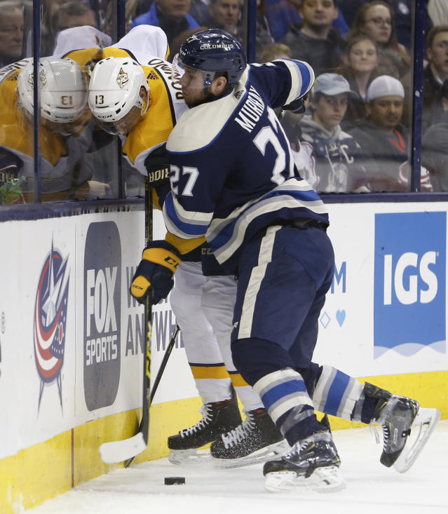 Columbus Blue Jackets' Ryan Murray, right, checks Nashville Predators' Nick Bonino during the third period of an NHL hockey game Thursday, Jan. 10, 2019, in Columbus, Ohio. The Blue Jackets beat the Predators 4-3 in overtime. (AP Photo/Jay LaPrete)