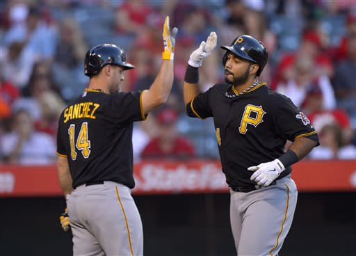 Pittsburgh Pirates' Pedro Alvarez, right, is congratulated by Gaby Sanchez after hitting a solo home run during the second inning of their baseball game, Saturday, June 22, 2013, in Anaheim, Calif. (AP Photo/Mark J. Terrill)