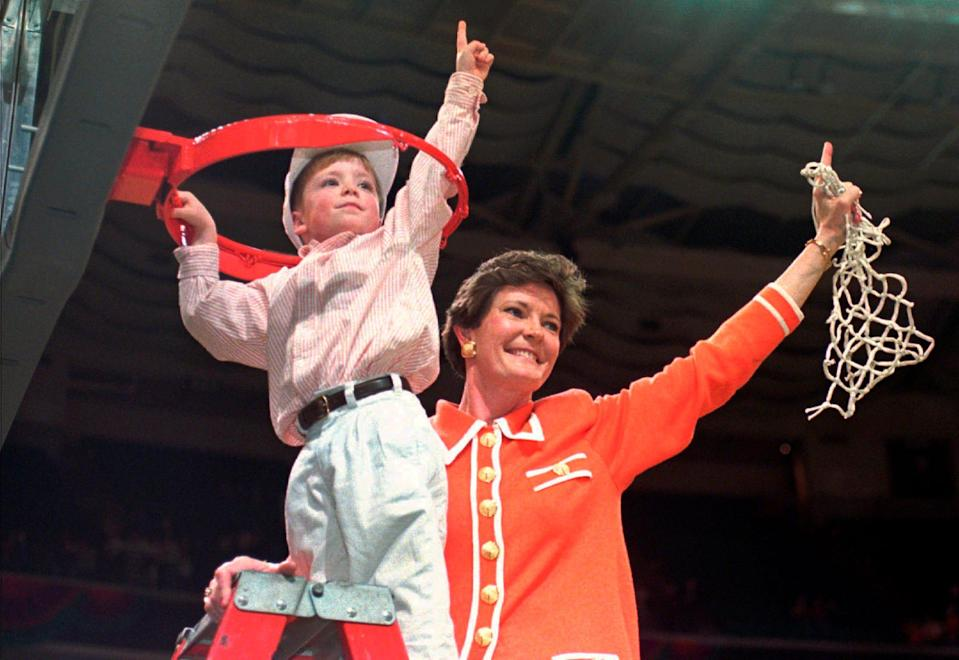 FILE - In this March 31, 1996, file photo, Tennessee coach Pat Summitt and son Tyler, take down the net after Tennessee defeated Georgia 83-65 in the title game at the NCAA women's basketball Final Four at Charlotte Coliseum in Charlotte, N.C. Summitt, the winningest coach in Division I college basketball history who uplifted the women's game from obscurity to national prominence during her career at Tennessee, died Tuesday morning, June 28, 2016. She was 64. (AP Photo/Pat Sullivan, File) ORG XMIT: NY203