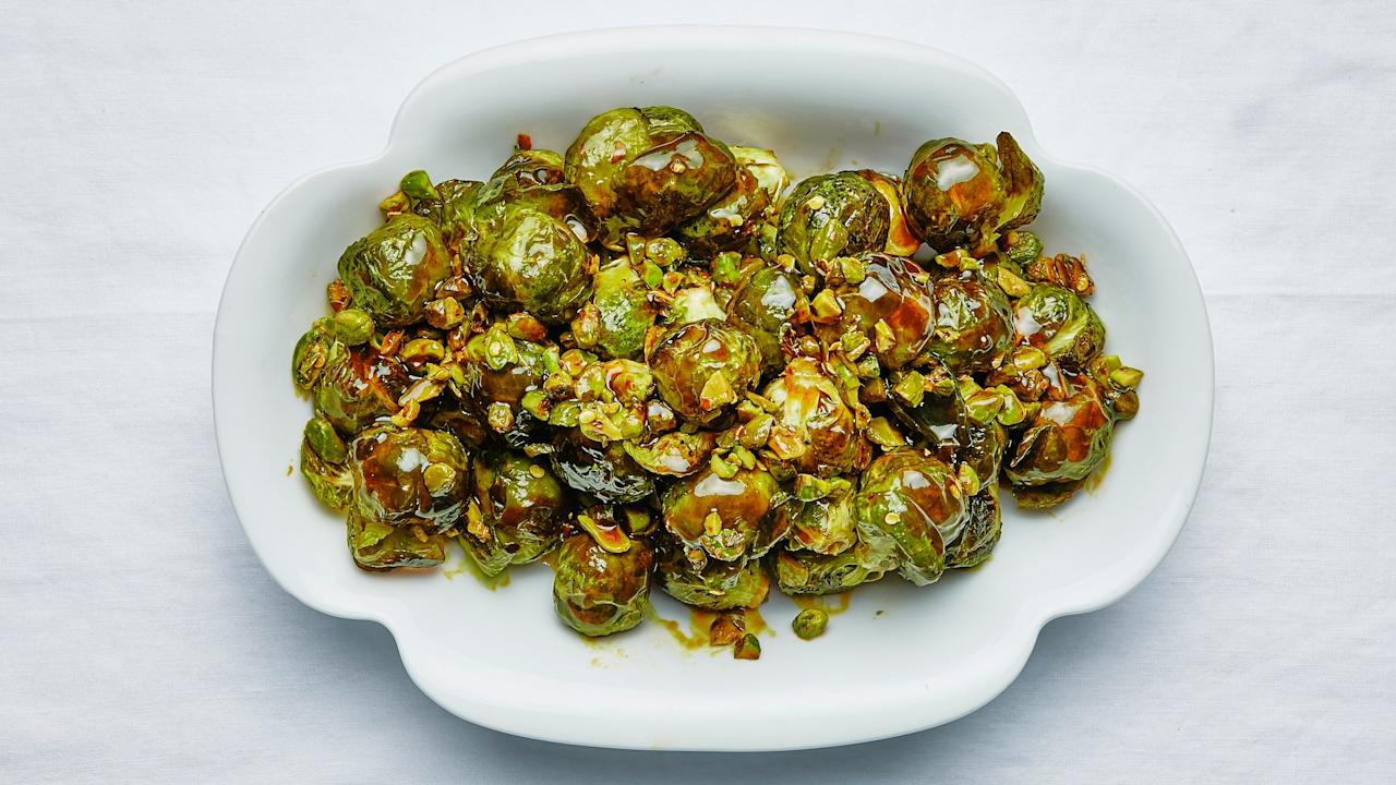 "These roasted whole brussels sprouts get so crispy on the outside you'll worry they're burnt (they're not!). Inside though, they're perfectly, deliciously mushy—which, according to us, isn't a bad thing. Of course, it gets even better when you coat them in a date molasses–brown butter glaze. Typically made from dates and nothing else, date molasses has a thick consistency and brings a deep, fruity sweetness and a bit of tartness. The Test Kitchen likes <a href=""https://www.amazon.com/Al-Wadi-Molasses-24-7-Ounce-Natural/dp/B075RDTJD7/"">Al Wadi Al Akhdar brand</a> or <a href=""https://www.amazon.com/Just-Date-Syrup-Glycemic-Gluten-free/dp/B07G5KMT5N/"">Just Date Syrup</a>. See all of the <a href=""https://bonappetit.com/gallery/absolutely-perfect-thanksgiving-menu"">Absolutely</a><a href=""https://bonappetit.com/gallery/making-perfect-thanksgiving-menu"">, Positively Perfect Thanksgiving recipes here</a>. <a href=""https://www.bonappetit.com/recipe/brussels-sprouts-with-pistachios-and-lime?mbid=synd_yahoo_rss"">See recipe.</a>"