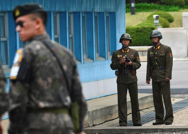 "North Korean and South Korean soldiers stand just metres apart at Panmunjom, one of the world's most heavily militarised borders, where US Vice President Mike Pence declared Monday that ""all options are on the table"" for dealing with Pyongyang"