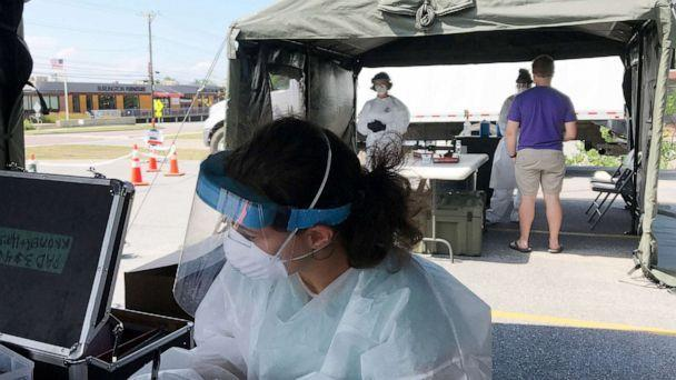 PHOTO: Health officials prepare to screen Vermonters for COVID-19 at a pop-up test site at Champlain Elementary School on July 23, 2020.<p>Bur20200723 Covid Testing 02 (Joel Banner Baird/Burlington Free Press via USA Today Network)</p>