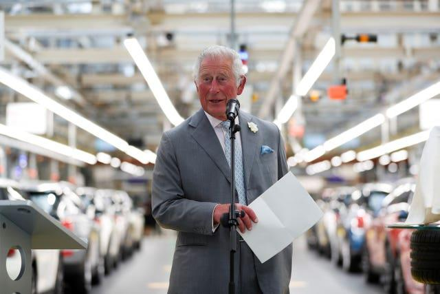 The Prince of Wales speaks during a visit to the Mini plant in Oxford (Peter Nicholls/PA)