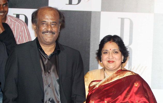 Rajnikanth with his wife at Big Bs birthday bash