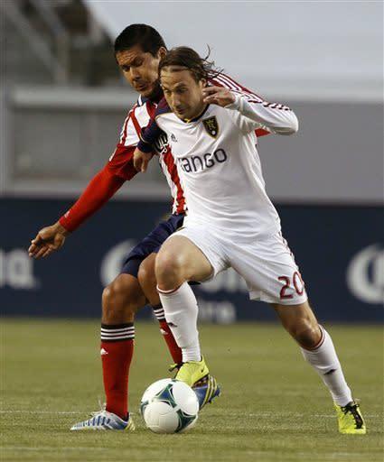 Real Salt Lake midfielder Ned Grabavoy (20) battles for control of the ball with Chivas USA defender Walter Vilchez, left, during the first half of an MLS soccer game in Carson, Calif., Sunday, May 19, 2013. (AP Photo/Alex Gallardo)