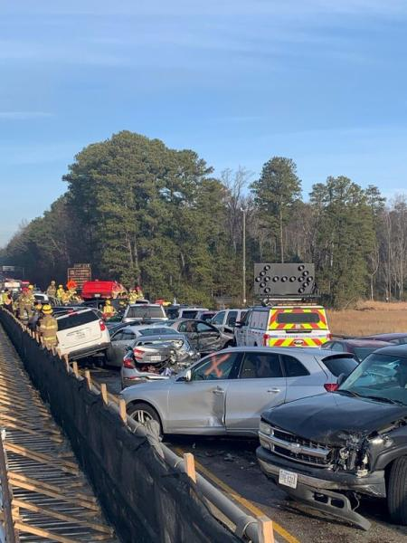 Damaged vehicles are seen after a chain reaction crash on I-64 in York County, Virginia