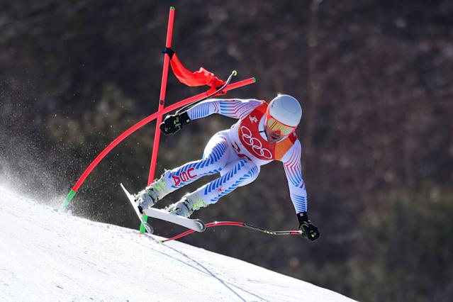 "<p>Travis Lindquist, Senior Director, Editorial Photography, Getty Images Photo - Tom Pennington <br>Using a long telephoto lens and a fast shutterspeed Getty Images photographer Tom Pennington was able to capture the incredible speed and control of this skier during the Men's Alpine Downhill <br>Combined. Seeing the gate contorted after the skier hit it and nearly 100km per hour and still maintaining his form, control, and concentration is a testament to skill these athletes have and the <br>talent the photographer has to capture everything in this split second. <br>Our photographers covering the Alpine skiing are facing extreme temperatures, their day on the mountain often begins before sun up in an effort to scout the course to find the best shooting location with the given course set or gate placement. The gates change for the Downhill and Super G, so the photo positions often need to be changed around. In addition to scouting on course, they are constantly scanning outside the A-net and B-net fencing for possible off course photo positions and Alpine is one of the only sports where they are required to be in their shooting position one hour before competition/training begins and they cannot move from these positions. These photo positions are often no larger than 10""X3"", so there is very little room to move around to stay warm – very challenging!!</p>"