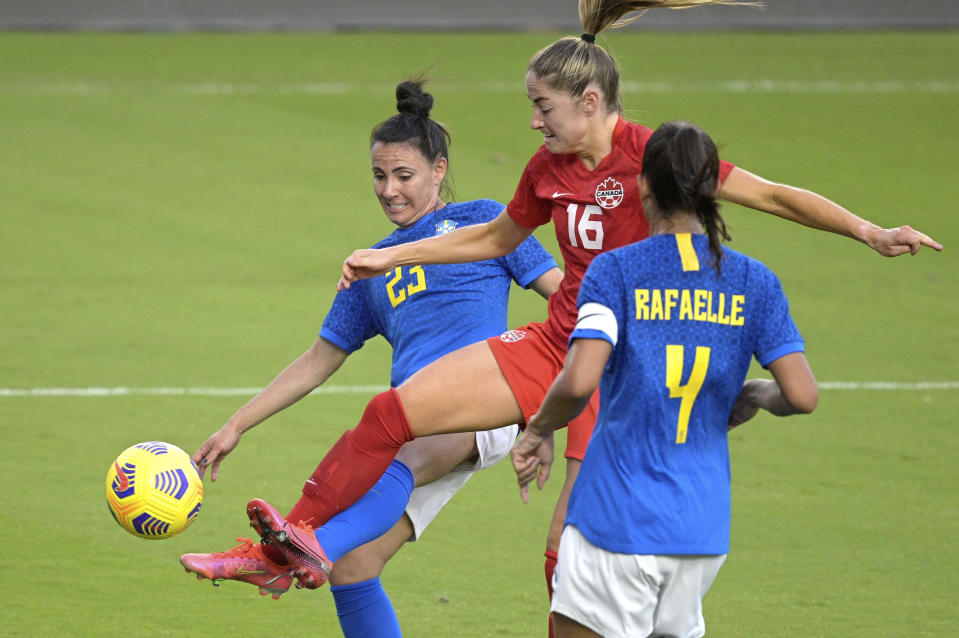 Brazil's Jucinara (23) and Rafaelle (4) defend as Canada forward Janine Beckie (16) attempts a shot on goal during the second half of a SheBelieves Cup women's soccer match, Wednesday, Feb. 24, 2021, in Orlando, Fla. (AP Photo/Phelan M. Ebenhack)