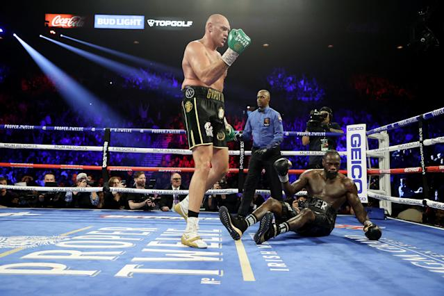 Tyson Fury heads to a neutral corner as a body shot knocked down Deontay Wilder in the fifth round during their heavyweight title bout Saturday at the MGM Grand Garden Arena in Las Vegas. (Photo by Al Bello/Getty Images)