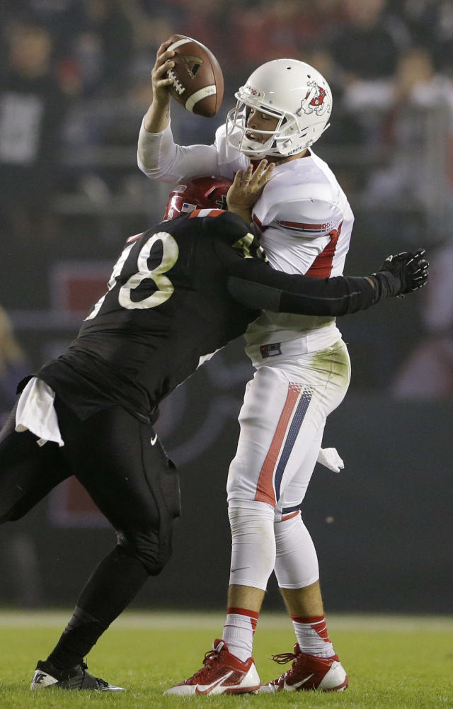 Fresno State quarterback Derek Carr is sacked by San Diego State linebacker Josh Gavert during the first half in an NCAA college football game Saturday, Oct. 26, 2013, in San Diego. (AP Photo/Gregory Bull)