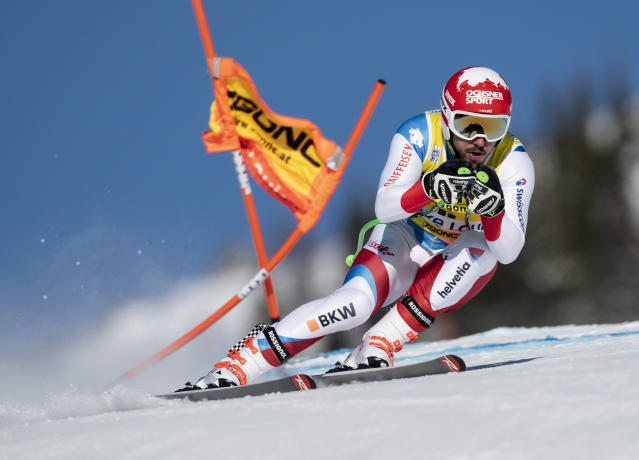 Carlo Janka, of Switzerland, races down the course during a training run for the men's World Cup downhill ski race in Lake Louise, Alberta, Canada, on Friday, Nov. 29, 2019. (Frank Gunn/The Canadian Press via AP)