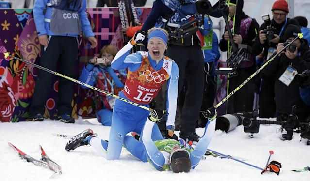 Finland's Iivo Niskanen, top, and Sami Jauhojaervi celebrate after winning the gold medal in the cross-country team sprint competitions at the 2014 Winter Olympics, Wednesday, Feb. 19, 2014, in Krasnaya Polyana, Russia. (AP Photo/Lee Jin-man)